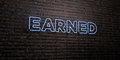 EARNED -Realistic Neon Sign on Brick Wall background - 3D rendered royalty free stock image