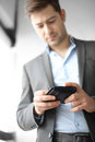 Earning man in suit holds in hand wallet Stock Images