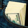 Earnings pack of dollars in a jeans pocket Stock Image