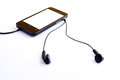 Earphone black with isolated background Royalty Free Stock Photography