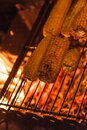 Ears of corn on a grill over high heat, night shooting. Royalty Free Stock Photo