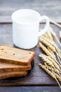 Ears of Wheat, Bread and Milk on Wooden Background Royalty Free Stock Photo