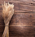 Ears of wheat on old table wooden Stock Images