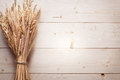 Ears of wheat on old wooden table Stock Photography