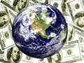 Earth with $100 bills background Stock Photos
