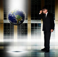 Man inspecting Earth Royalty Free Stock Photo