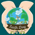 Earth day, happy planet surrounded by clouds in hands of man, globe on open palms, ecology world concept, green and blue Royalty Free Stock Photo