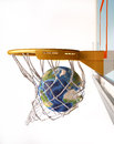 Earth globe centering the basket close up view of basketball with inside net at white background image sources were Royalty Free Stock Images