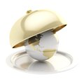Earth globe on ceramic salver under a golden food cover Royalty Free Stock Photo