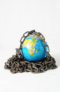 Earth globe close in chain d and padlock Royalty Free Stock Photo