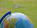 The earth globe on green grass background Royalty Free Stock Photography