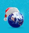 Earth globe and santa hat Royalty Free Stock Photo