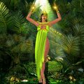 Earth goddess a sensual standing amongst plants with her arms raised and mystical lights illuminating the scene her green dress Stock Images