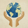 Earth in hands recycled paper craft Royalty Free Stock Images
