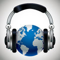 Earth with headphones. Royalty Free Stock Photo
