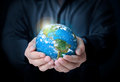 Earth in human the hand some components of this image are provided courtesy of nasa Stock Image