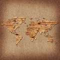 Earth map shape from the wooden desk over old cardboard backgrou Royalty Free Stock Photo