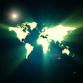 Earth map shiny and rays on dark background Stock Photography