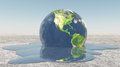 Earth melting into water Royalty Free Stock Photo