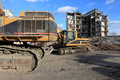Earth mover and industrial ruins Royalty Free Stock Photo