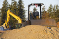Earth movers heavy industrial equipment used to move soil and Stock Images