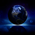Earth planet on a reflective surface elements of this image are furnished by nasa Royalty Free Stock Photos