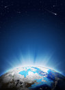 Earth planet in sun rays elements of this image are furnished by nasa Royalty Free Stock Photos