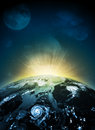 Earth planet in sun rays elements of this image are furnished by nasa Stock Photo