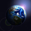Earth planet in sun rays elements of this image are furnished by nasa Royalty Free Stock Images