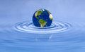 Earth planet on blue water ripple Royalty Free Stock Photo