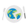 Earth on plate. Globe cut with a knife. Cutlery: knife and fork. Royalty Free Stock Photo