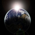Earth seen from space at sun dawn and stars Royalty Free Stock Photo