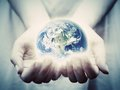 The earth shines in young woman hands. Save the world Royalty Free Stock Photo