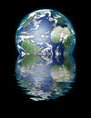 Earth sinking and watery reflection on black image credit nasa Stock Image