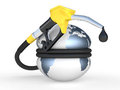 Earth squeezed and fuel pump nozzle with drop oil Royalty Free Stock Images