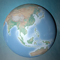 Earth standing on clean space asia Royalty Free Stock Photography