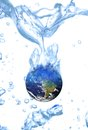 Earth water concept global warming floating in a glass white background Royalty Free Stock Photo