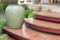 Earthen jar decorated on wooden stairway green Stock Photography