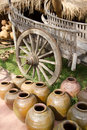 Earthen pots and buckboard Royalty Free Stock Photography