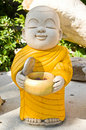 Earthenware of child monk Stock Photo