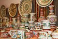 Earthenware on the shelves of shop. Pottery for sale