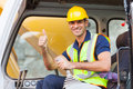 Earthmover operator giving thumb up on construction site Royalty Free Stock Photography