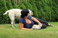 Ease in garden woman cat and dog Stock Photo