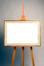 Easel with antique painting frame cross processed image Royalty Free Stock Photo
