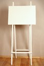 Easel in the interior close up of white stands Royalty Free Stock Photo
