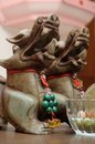 East Asian mythical statuettes on display Royalty Free Stock Photo