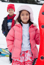 East Indian kids toboganning in the snow Royalty Free Stock Image