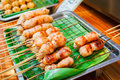 East sausage being grilled, Thai food style. Royalty Free Stock Photo