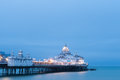 Eastbourne pier illuminated at dusk east sussex uk august england is a well known english seaside Royalty Free Stock Photo