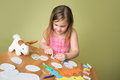 Easter activities and crafts child doing with bunny stickers egg shapes pencils markers Royalty Free Stock Image